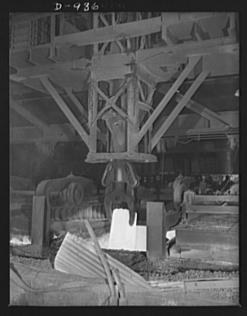 Steel alloy manufacture. Allegheny Ludlum Steel Corporation, Brackenridge, Pennsylvania. A heated ingot of steel is removed from the soaking pit. In this pit ingots are thoroughly heated to the extremely high temperature required for conversion into slabs, billets or sheet bars for further conversion