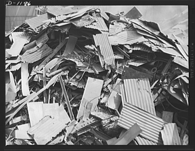 Steel manufacture, Allegheny-Ludlum. It won't be long now! Here's a pile of scrap collected from various roadside junkheaps for re-use by the steel mills producing for defense. Soon it will be loaded into open hearth and other types of furnaces to be used in the production of new steel for defense industry. Nearly forty percent of the steel produced comes from scrap metals