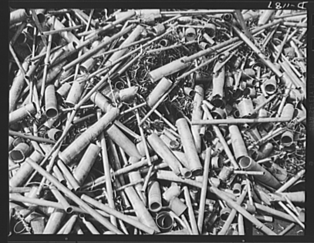 Steel manufacture, Allegheny-Ludlum. It's the end of a short episode for this scrap steel accumulated from the croppings of tubing and piping right in the steel mill. This scrap will be charged into steel converters once again, and again will emerge as refined steel for industrial production. Steel mills themselves provide large portions of the scrap metal needed for production