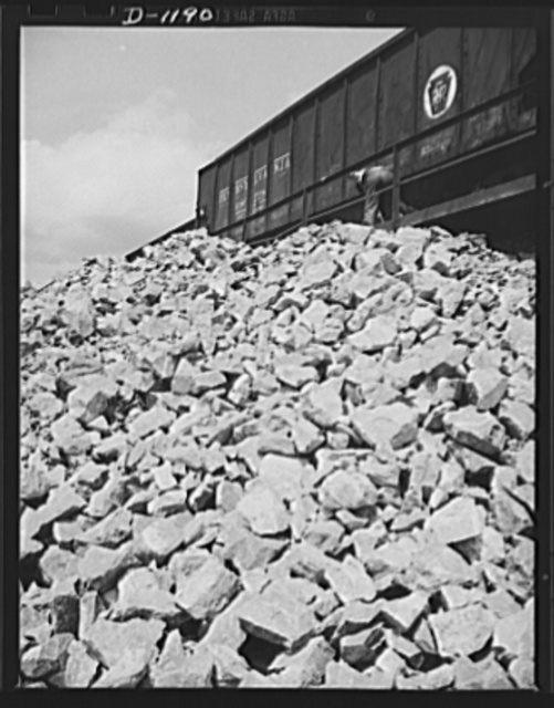 Steel manufacture, Allegheny-Ludlum. This doesn't look very impressive, just a pile of rock. Well, that's what it is, a pile of limesone, but since limestone is the main ingredient for the refining of high quality steels, heaps of rock such as these mighty important factors in the maintenance of defense production