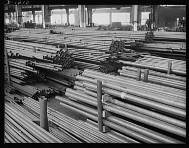 Steel manufacture, Allegheny-Ludlum. This quality steel tubing and piping will eventually be used to convey, refine or distill elements used in defense production. Expensive alloy steels are used, particularly for chemical piping. Special alloys have been devised to resist specific chemicals