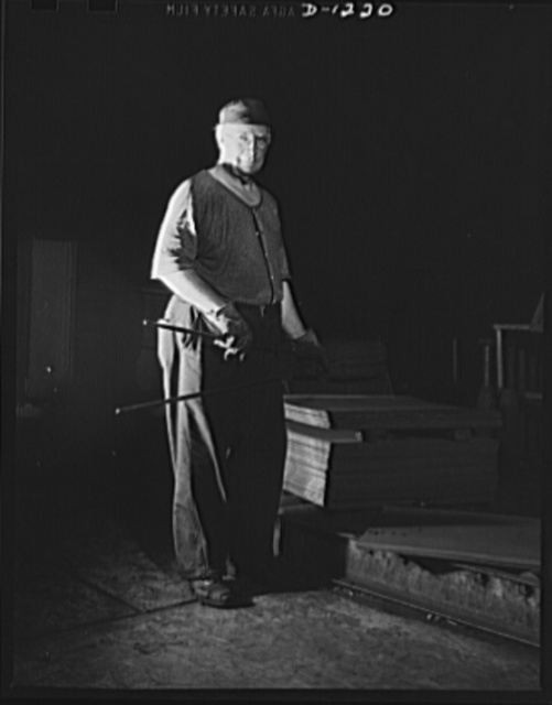 Steel manufacture, Allegheny-Ludlum. This sheet mill worker is charging sheets of steel into the heating furnace, from which they will emerge to be rolled into thin gauge sheets