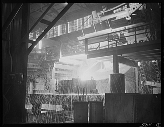 Steel manufacture, Allegheny-Ludlum. White-hot steel pours like water from a thirty-five ton electric furnace. The finest quality steels and alloys are produced in these furnaces, which allow much greater control of temperature than other conversion furnaces. The proportion of electric furnace steel is rising steadily, even though this process is the most expensive. The furnace is tiled for the pourings. The flying sparks indicate the fluidity of the steel