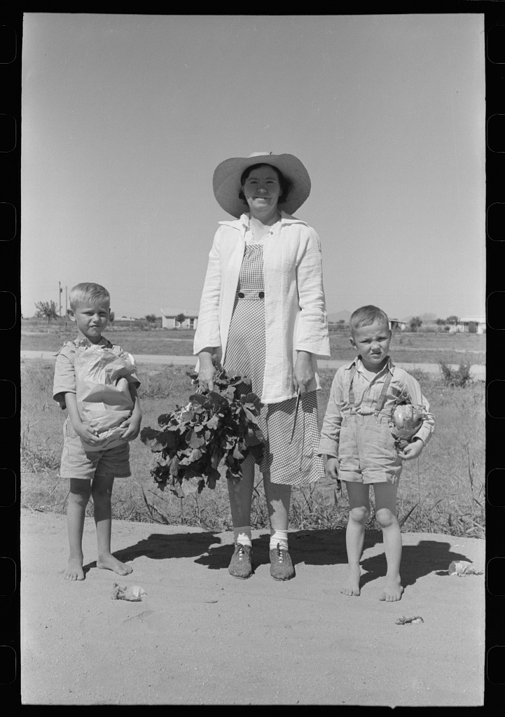 Supervisor of the Work Projects Administration nursery school and boys with vegetables from the community garden at the Casa Grande Valley Farms, Pinal County, Arizona. These vegetables will be prepared for the children's lunches at the nursery school