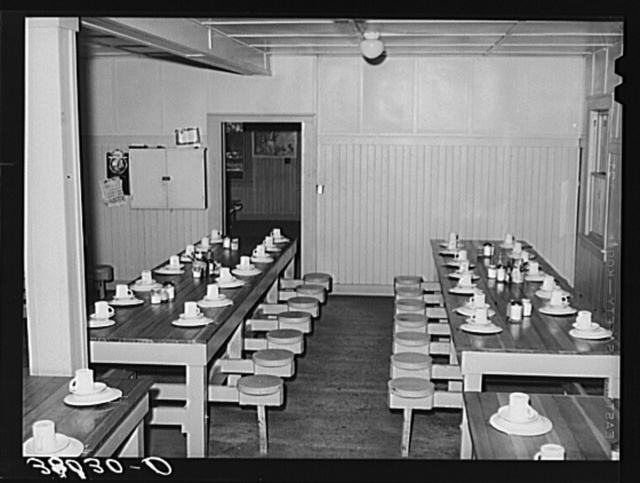Tables in mess hall for single men who are permanent workers at the Earl Fruit Company ranch. Kern County, California