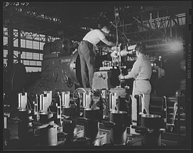 Tank manufacture (Chrysler). Efficient control of the 75 mm field guns with which M-3 tanks are equipped is assured by these careful workers. They are finishing the boring bronze bushing for the gun mount. They are only two of the 10,000 skilled workers turning out these twenty-eight ton land battleships at the huge Chrysler tank arsenal in Detroit