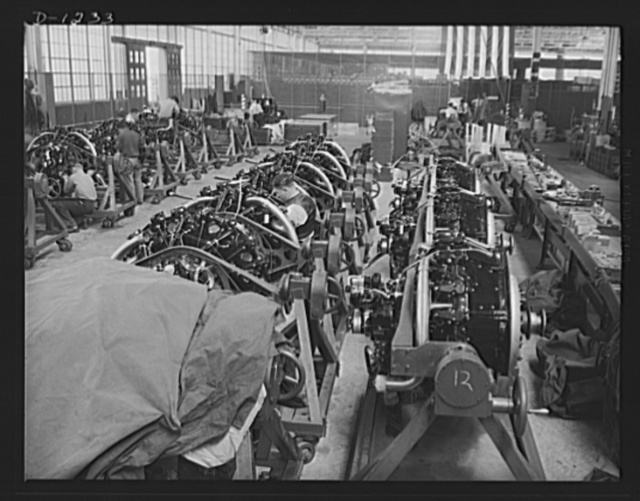 """Tank manufacture (Chrysler). M-3s, the twenty-eight ton """"medium"""" tanks being turned out in Detroit at the Chrysler tank arsenal, are powered by nine cylinder, 400 horsepower Wright Whirlwind aviation type engines. This is a general view of the final engine assembly department"""