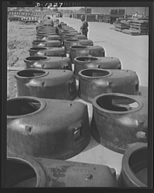 Tank manufacture (Chrysler). Ready for installation in Chrysler M-3 tanks, these routh turret castings, which weigh 4,000 pounds each, have just been received at the huge Detroit tank arsenal where 10,000 men are turning out these twenty-eight ton rolling arsenals
