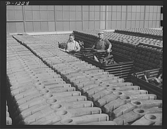 Tank manufacture (Chrysler). Stockpiles such as these need constant replenishment now that M-3 tanks have reached a mass production schedule. These are wheel suspension lever forgings, stored outside the huge Chrysler tank arsenal in Detroit where 10,000 workers are turning out twenty-eight ton rolling arsenals for the Army