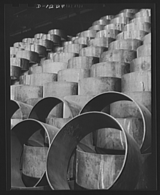 Tank manufacture (Chrysler). Stockpiles such as these need constant replenishment now that M-3 tanks have reached a mass production schedule. These are wheel suspension lever forgings, stored outside the huge Chrysler tank arsenal in Detroit where 10,000 workers are turning out 28 ton rolling arsenals for the Army