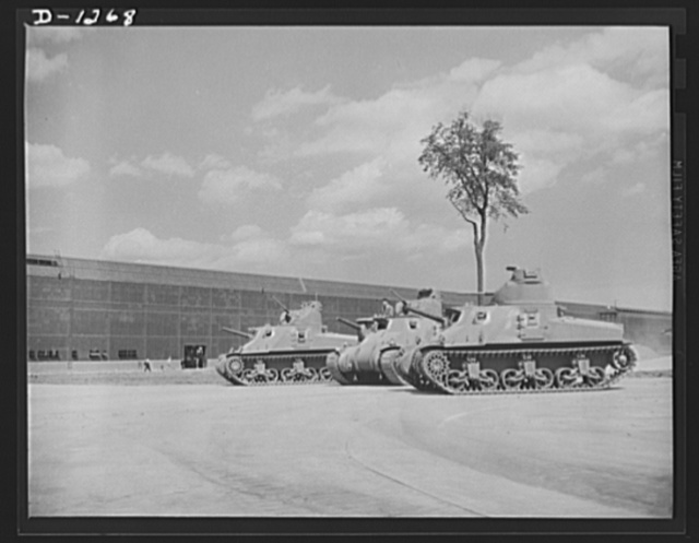 Tank manufacture (Chrysler). Test is thorough at the proving grounds adjoining the Chrysler tank arsenal near Detroit. These are twenty-eight ton M-3 tanks, the steel monster which will make our mechanized forces the equal of any in the world in tank warfare. The lower of the two gun barrels is that of a 75 mm. gun, the upper of a 37 mm. anti-aircraft gun, both standard equipment on these tanks. In addition, four machine guns are mounted on each M-3
