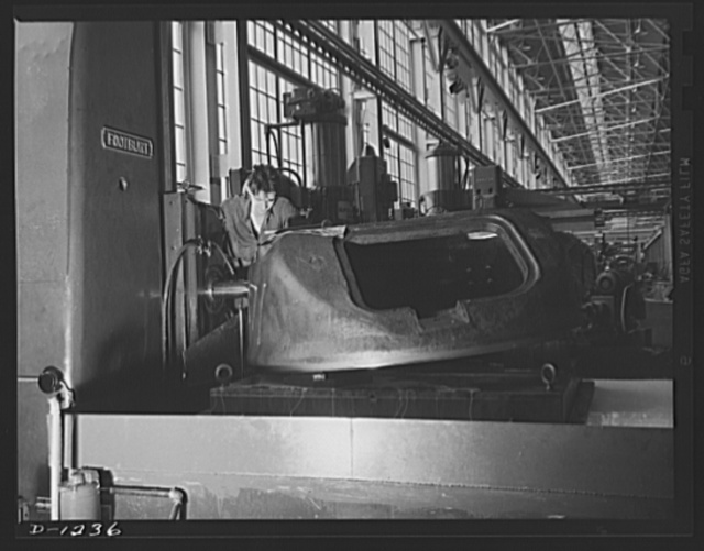 Tank manufacture (Chrysler). This turret casting for an M-3 tank weighs 4,000 pounds. The worker is completing one of the several milling operations necessary to insure perfect fit, for the gun which will fire from behind the turret must have freedom of movement. The tank itself, which might be termed an arsenal on tracks, weighs twenty-eight tons. It is now in mass production at the huge Chrysler tank arsenal in Detroit