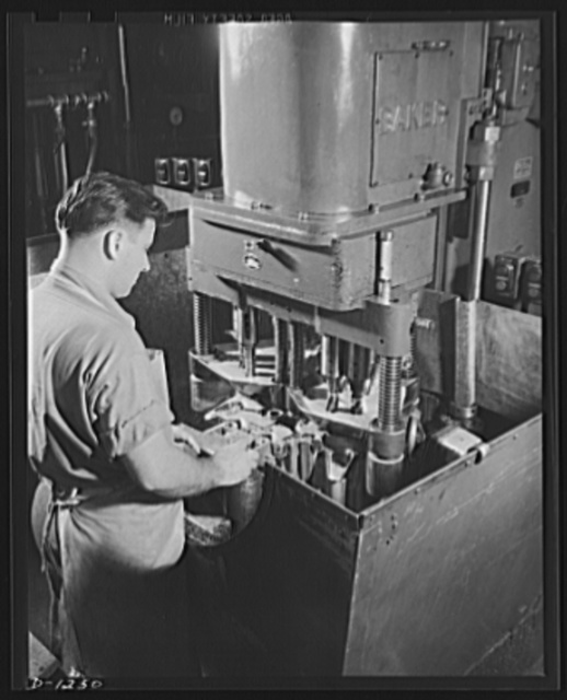 Tank manufacture (Chrysler). This worker is operating an eight-inch spindle machine designed for drilling and finish reaming of the show track and plates of an M-3 tank. Hundreds of specially designed machine tools are used in production of these twenty-eight ton steel giants, at the huge Chrysler tank arsenal, in Detroit