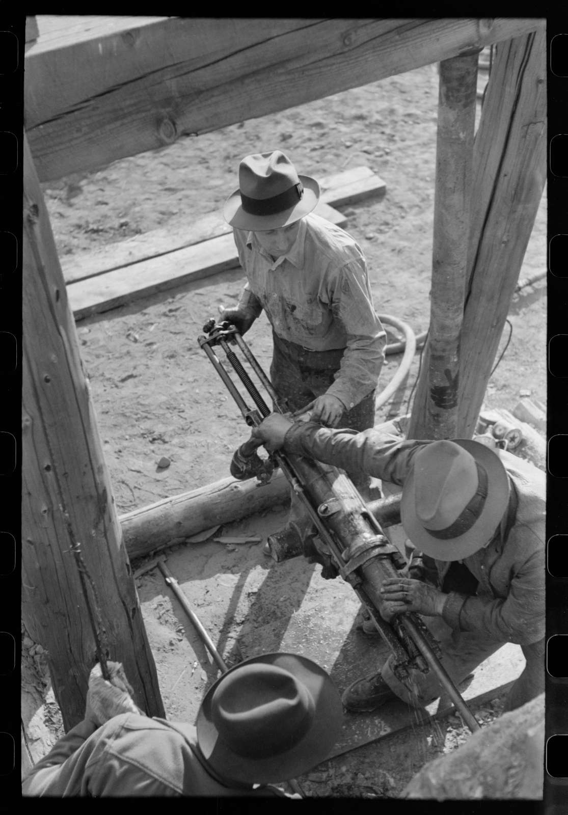 Team of two gold miners operating hand drill in contest on Labor Day, Silverton, Colorado