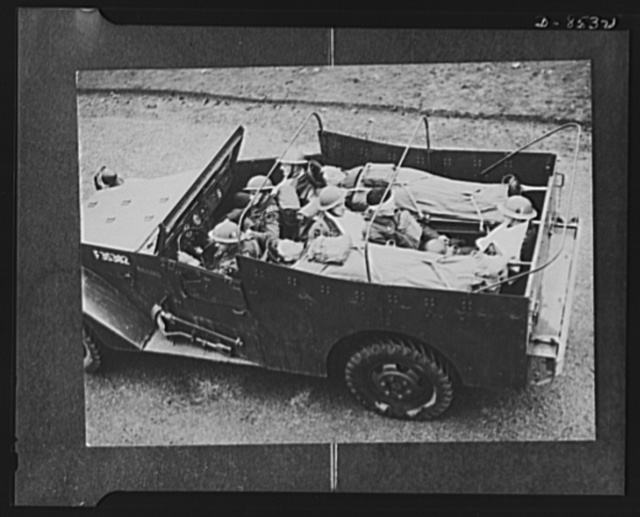 """The Army uses """"lend-lease"""" equipment now being used by British armoured forces, is a """"white"""" scout car which has been converted into an ambulance for use with tanks. It has been proven to have a fine cross-country performance"""