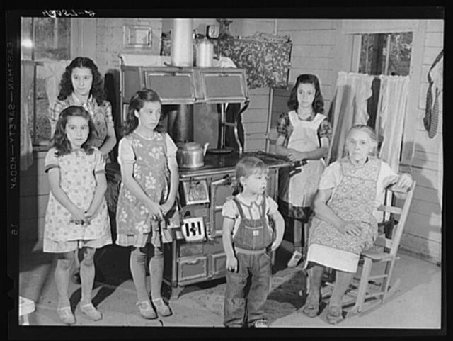 The children and mother of Mr. Patrick Dummond, French-Canadian potato farmer in Lille, Maine