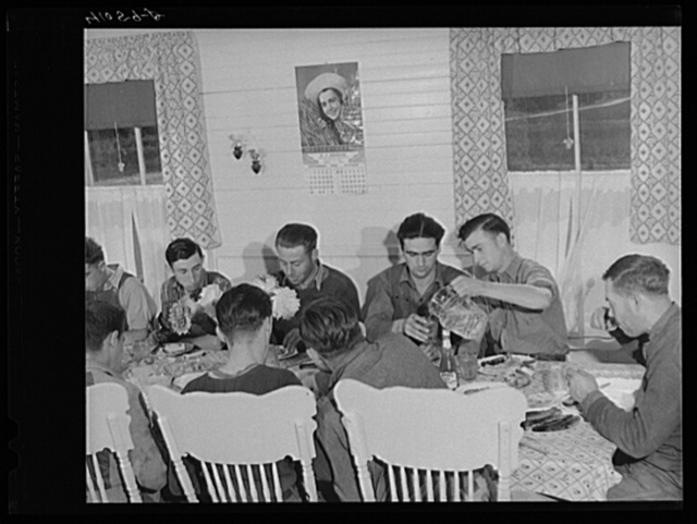 The foremen and tractor operators of the Woodman Potato Company at lunch.  Near Caribou, Maine
