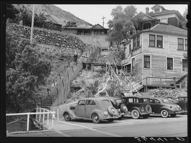 The houses of Bisbee, Arizona, are built along the sides of the mountains and long stairways are necessary to reach them. This is a copper mining center