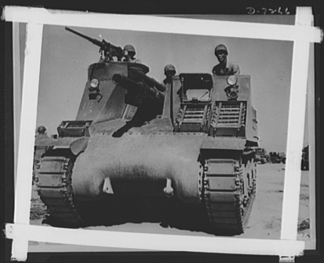 The M-7 is the Army's newest tank destroyer and is being given the acid test for desert warfare in the maneuvers near Iron Mountains, California.  Colonel R. Downing of DeKalb, Missouri, Corporal L. Roberts from Graham, Texas, and Lieutenant M. Hutchison, Enterprise, Alabama. For firing power, the M-7 has a 105 mm Howitzer and a 50 caliber automatic gun. Iron Mountains, California.