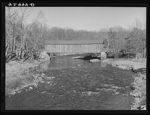 "The ""old comstock bridge,"" three miles West of Colchester, Connecticut on Route 16. It was repaired by the CCC (Civilian Conservation Corps)"