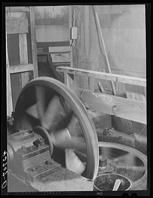 The old Kenyon's johnnycake flour mill in Usquepaugh is run by water power. The waterwheel is underneath the mill and by means of these two gears its power is brought into the mill