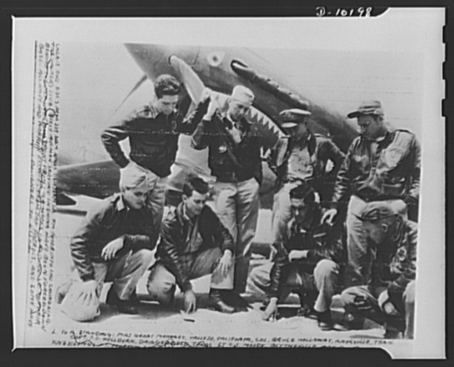 """""""The Walkers Club."""" Eight U.S. airmen in China who were forced down behind the Japanese lines. After a period of eight weeks and many narrow escapes of contacts with enemy patrols, they reached their bases. Left to right, standing: Major Grant Mahoney, Vallejo, California; Colonel Bruce Hollaway, Knoxville, Tennessee; Captain J.O. Wellborn, Daingerfield, Texas; Lieutenant C.C. Moody, Blytheville, Arkansas; Kneeling: Lieutenant Morton Sher, Greenville, South Carolina; Lieutenant C.C. Vaughn, Pearsall, Texas; Lieutenant R. Durell, Scarbrough, Hudson, New York; Lieutenant M.D. Marks, Bayonne, New Jersey"""