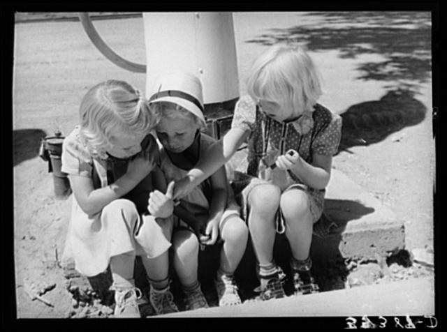 Three little Mormon girls with candy. Mendon, Utah