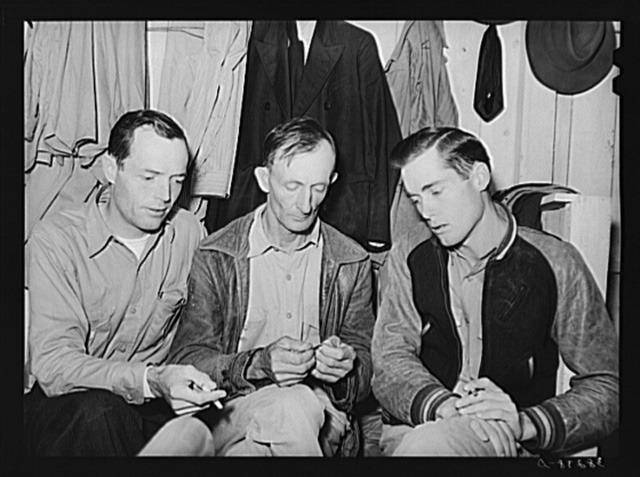 Three men workers at naval air base from Louisiana. These men are living in a tourist court and had to leave their families in Louisiana because they could not find suitable housing facilities. Corpus Christi, Texas