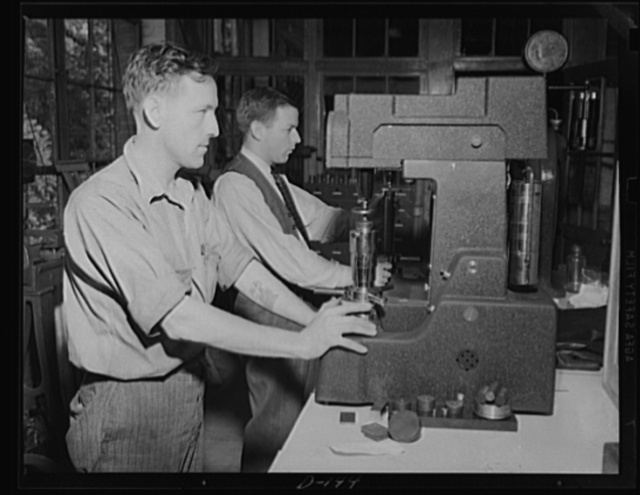 Tough steel for a tough job. It takes tough steel to stand up in a Garand rifle. Here workmen are testing the hardness of steel at an eastern armory, a center of war work