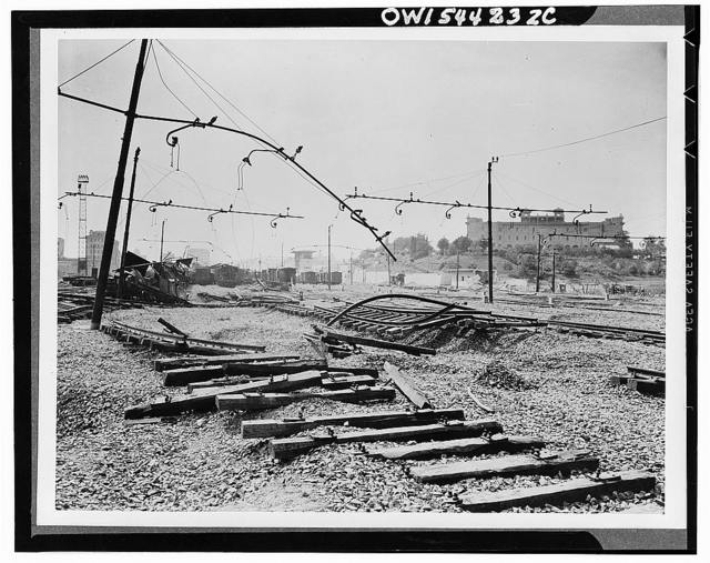Track damage in the Ostiense railroad yards as shown in a reconnaissance photo. In the background a monastery stands intact, untouched by bombs directed against military installations