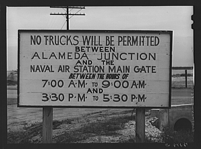 Traffic sign on road leading to the naval air base now under construction at Corpus Christi, Texas