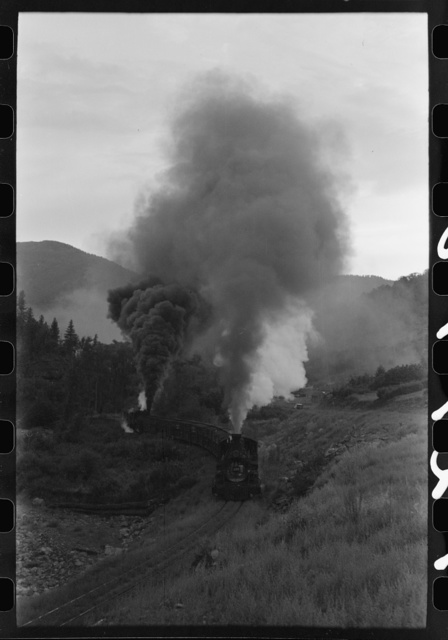 Train coming up the valley on a narrow gauge track, Ouray County, Colorado. Notice the two engines