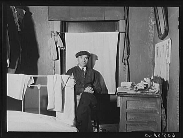 Transient farm laborer in hotel room which he rents for one dollar and fifty cents a week. Dubuque, Iowa