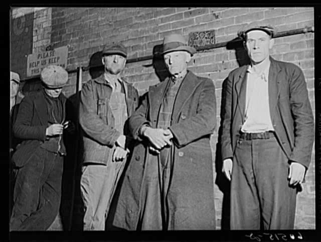 Transient men waiting in line for evening meal served at 5 p.m. at the city mission. Dubuque, Iowa