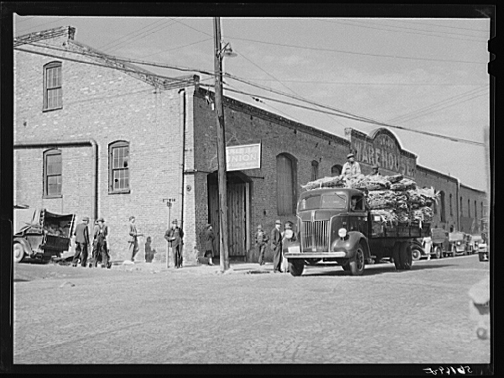 Transporting tobacco from warehouse after auction sale to the cigarette factories and storage warehouses. Danville, Virginia