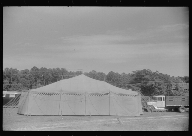 Traveling carnival at Old Trap, North Carolina. This troupe follows the migrants around and stops where there is a large settlement of them. A show generally consists of a band concert and movie and vaudeville