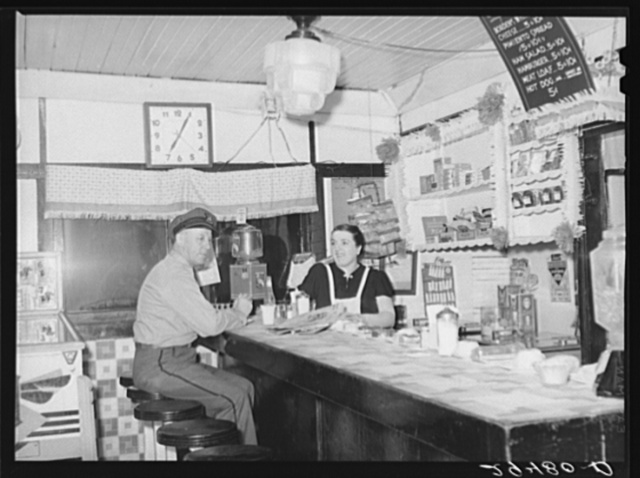 Truck driver in diner. Clinton, Indiana