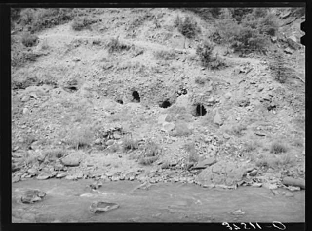 Tunnels dug into the sides of the banks of the San Miquel River in search for gold. San Miquel County, Colorado