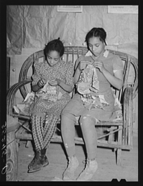 Two daughters of Pomp Hall, Negro tenant farmer, making patchwork cushions for chairs. Creek County, Oklahoma. See general caption number 23