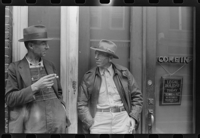 Two farmers talking in front of a bank in Roxboro, North Carolina