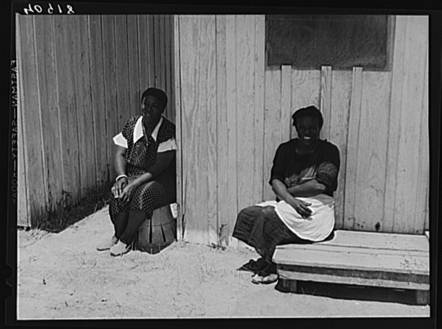 Two migratory workers at a camp in Vienna, Maryland, on a Sunday afternoon