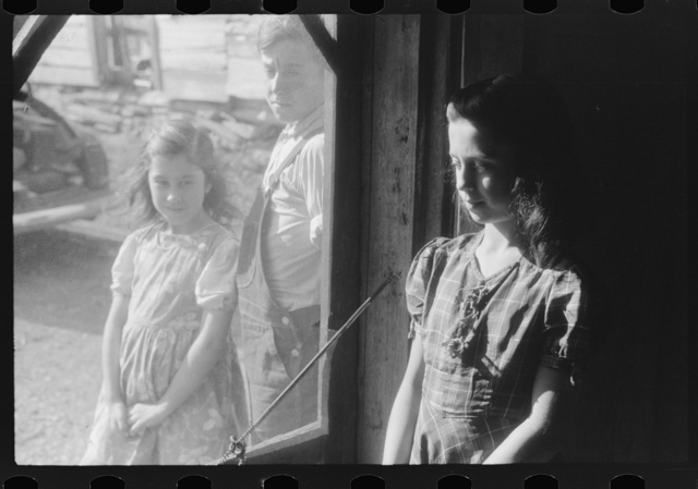 Two of the Dumond children at the back door of their home in Lille, Maine. French-Canadian potato farmers and FSA (Farm Security Administration) clients
