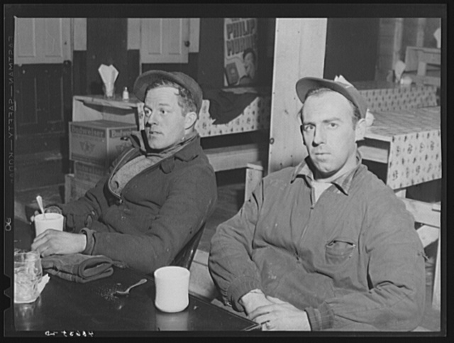 Two shipyard workers in for a cup of coffee after work at the Bath Iron Works. Left is Paul Jacobs and Ronnie Williams. Both live about eighteen miles outside of Bath, Maine