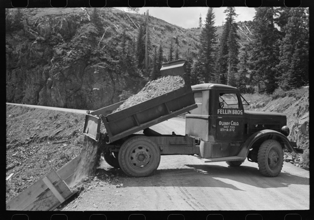 Unloading gravel to be used in mine building construction, Ouray County, Colorado