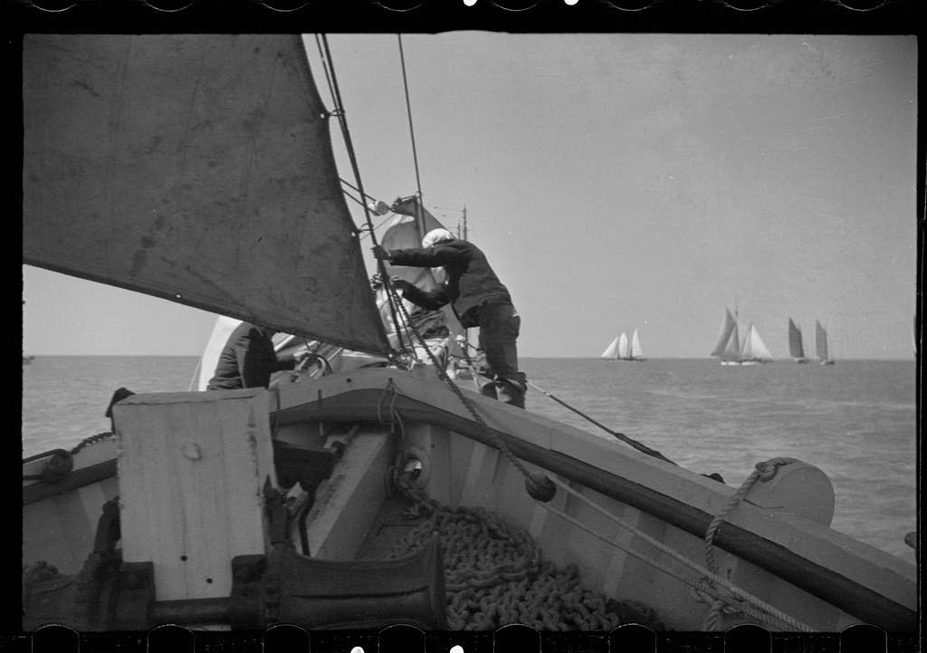 Untitled photo, possibly related to: Summer residents watch the tourist boat arrive from Boston, Provincetown, Massachusetts