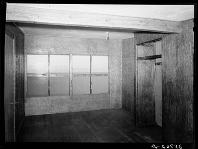 Upstairs bedroom and closet in multi-family unit for permanent agricultural workers at the migratory labor camp. Sinton, Texas