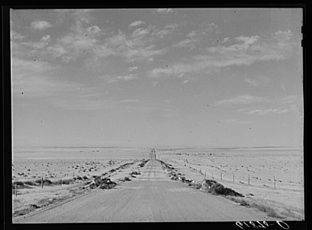 U.S. Highway no. 18 through Shannon County, South Dakota. Tumbleweeds lining edges of road