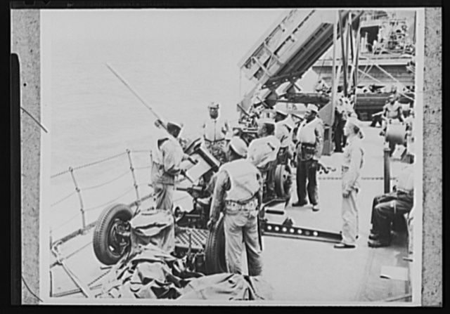 U.S. Negro troops on way to Liberia. As a U.S. Army transport plows through the Atlantic on its way to Liberia, Africa, the Negro crew of a 37mm anti-aircraft gun holds a shipboard practice session. The soldiers, members of a U.S. Army Engineer's unit, were especially interested in Liberia, a Negro Republic founded by their ancestors whose governmental system is patterned on that of the U.S.