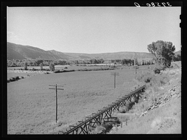 Valley of the Uncampaghre River with irrigation water conduit. Ouray County, Colorado