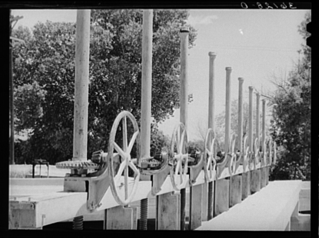 Valves to irrigation gates. Main irrigation canal in Maricopa County, Arizona